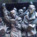 <em>'The Meeting Place'</em><br />Base of the Bronze statue
